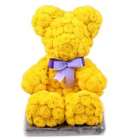 Yellow teddy with a tie-bow