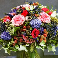 Original floristry: bouquet with berries and fruits